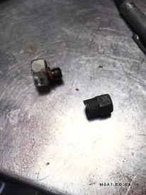 Plug removed and scrap nut to replace